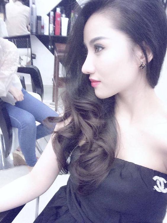 Long hair curled with bangs